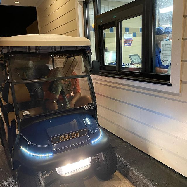 Man in a golf cart in a Culver's drive-thru