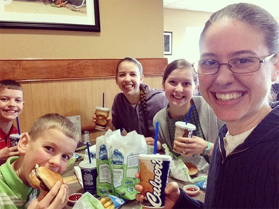 Family of five, two young boys, two young girls and mother, eating Culver's ButterBurgers®