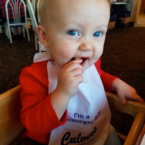 Baby enjoying her first Cheese Curds