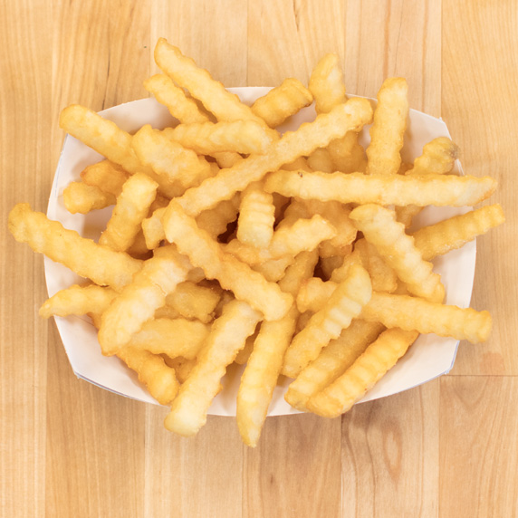 Culver's Crinkle Cut Fries in a paper tray on a wooden table