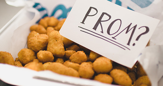 """A note that reads """"Prom?"""" sits inside a family-size order of Cheese Curds."""