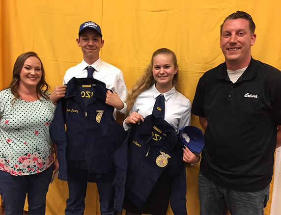 Culver's of Prescott Valley's owners, Caleb and Emily Meier, presenting blue jackets to FFA members.