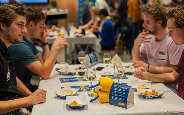A table of guests sample Culver's Cheese Curds and dipping sauces