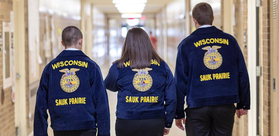 Group of FFA members walking through hall