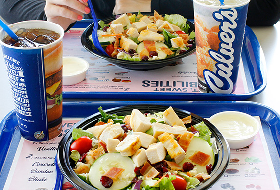 Two Culver's guests, both enjoying Cranberry Bacon Bleu Salads with Chicken.