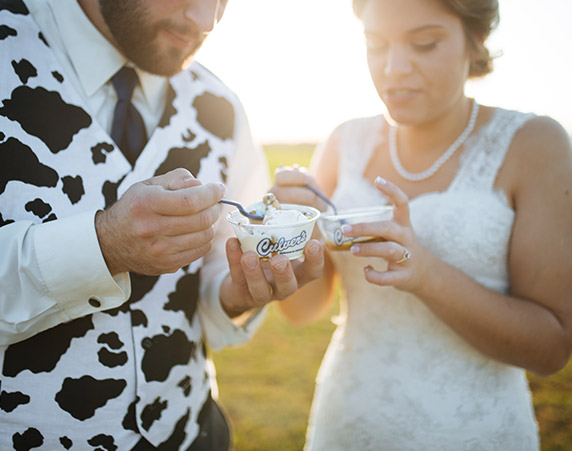 Katy and Cory B. (who is wearing a cow print vest) enjoy some Fresh Frozen Custard at their wedding.