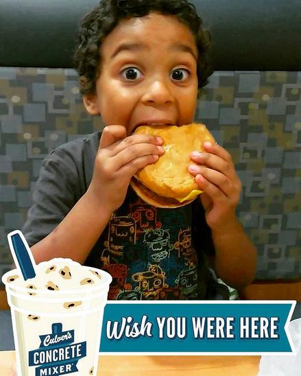 Kid enjoying his first ButterBurger