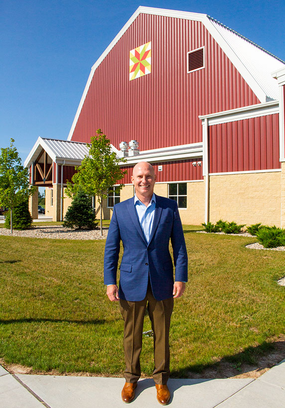 Culver's CEO Joe Koss stands in front of Farm Wisconsin Discovery Center