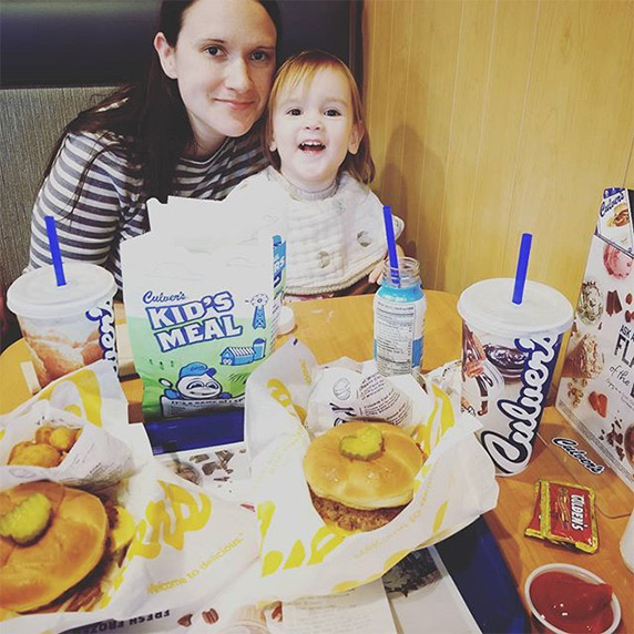 Mother and daughter sitting in Culver's restaurant booth sharing their love for ButterBurgers®