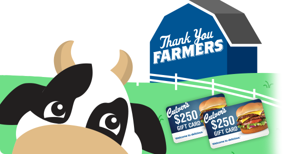 A cow and Culver's gift cards in front of the blue Thank You Farmers barn.