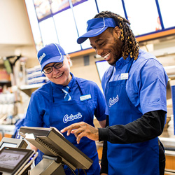 Two Culver's Team Members at the Front Counter Register