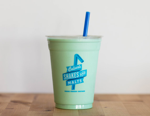 Culver's Mint Milkshake on a wooden table, waiting to be eaten.