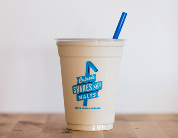 Culver's Salted Caramel Milkshake on a wooden table, waiting to be eaten.